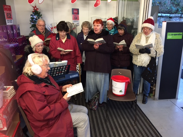 Carol singing at Co-op